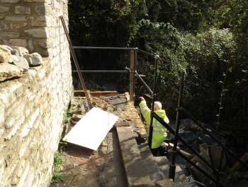 Safety railings being installed outside the Cornish Engine House