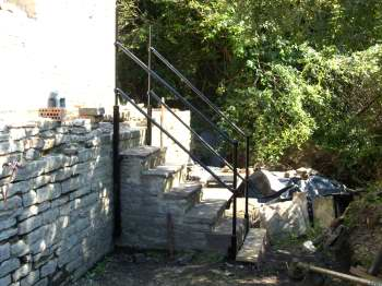 Hand rails around the steps outside the south-west wall of the CEH