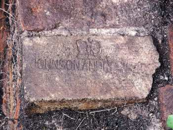 Brick with crown stamped into face